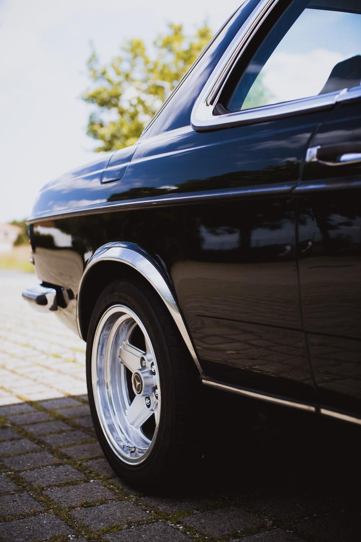 black car on gray pavement