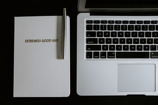 macbook pro beside black pen