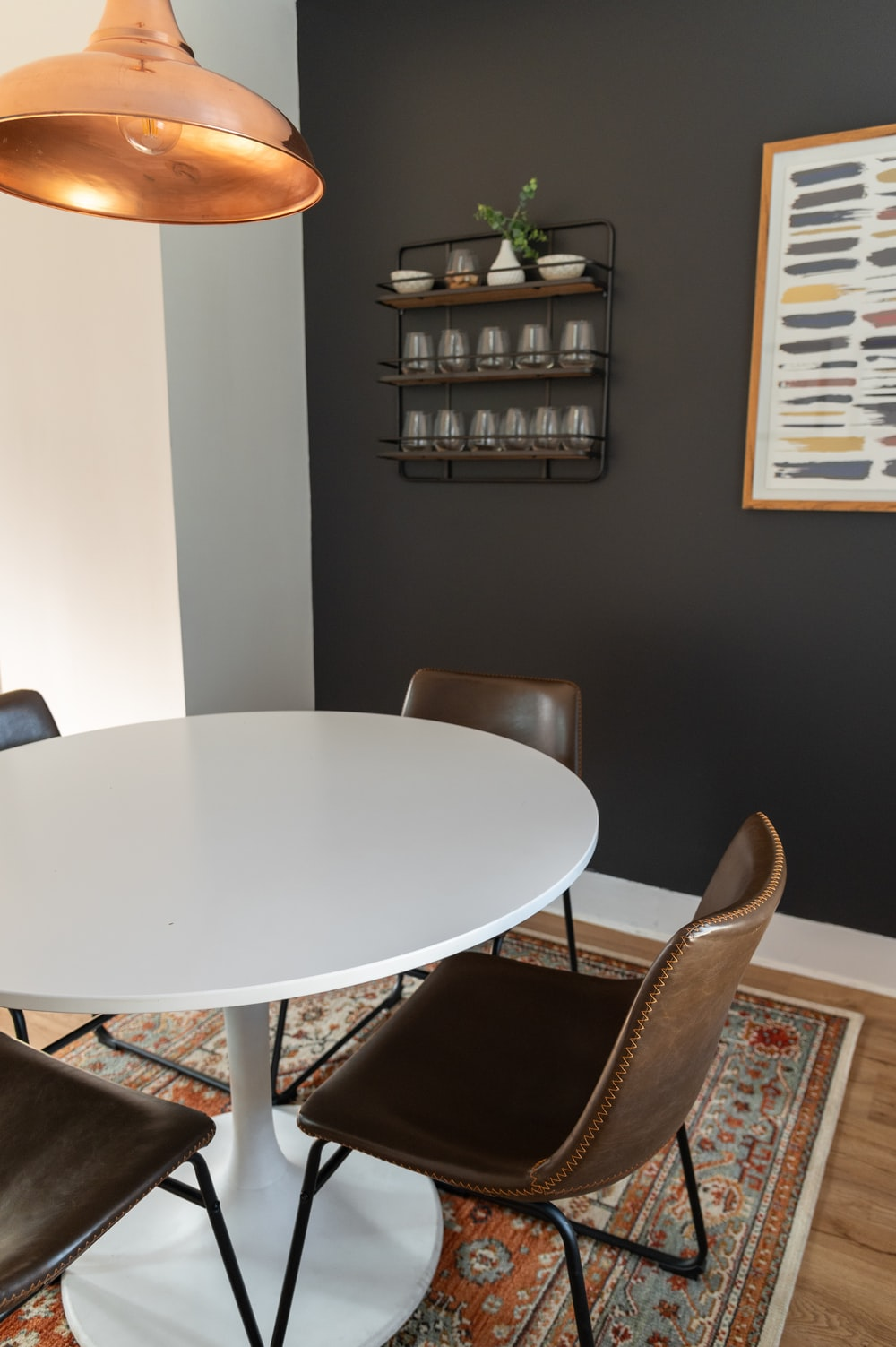 oval white wooden table with chairs