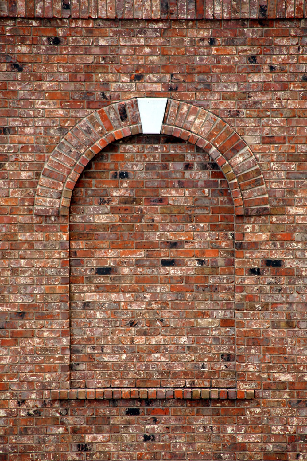 brown brick wall with hole