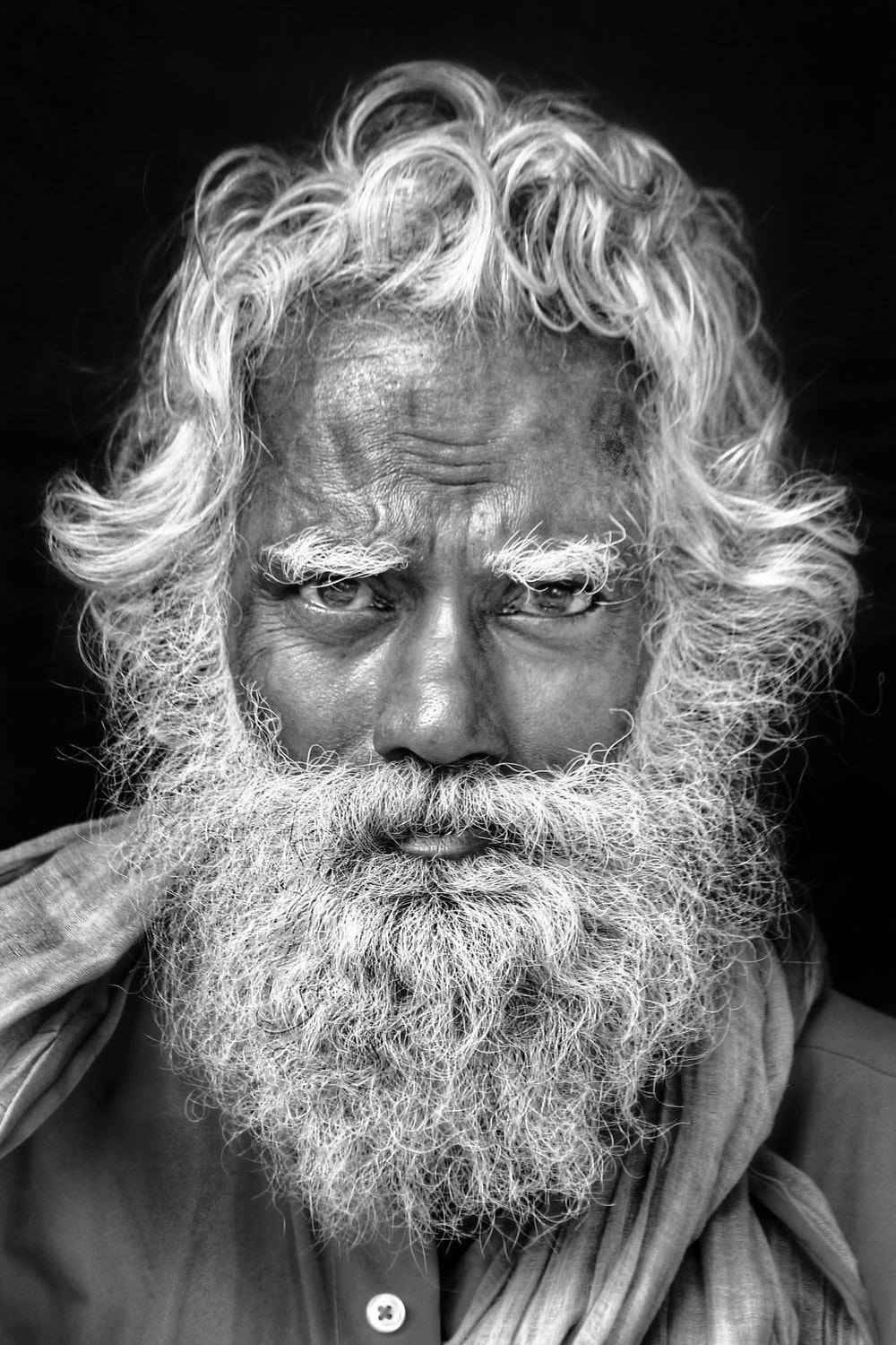 grayscale photo of man with long beard
