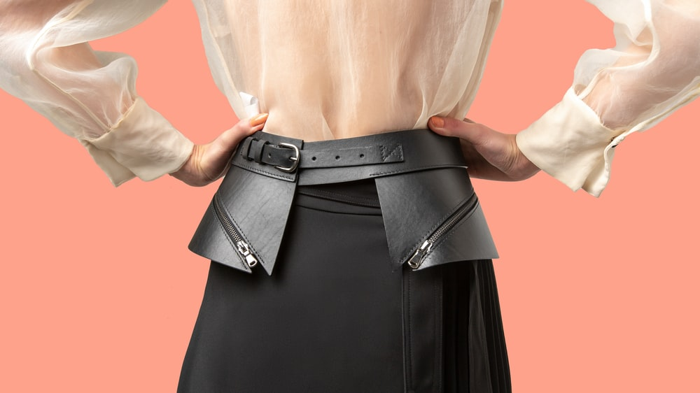 woman in black leather skirt