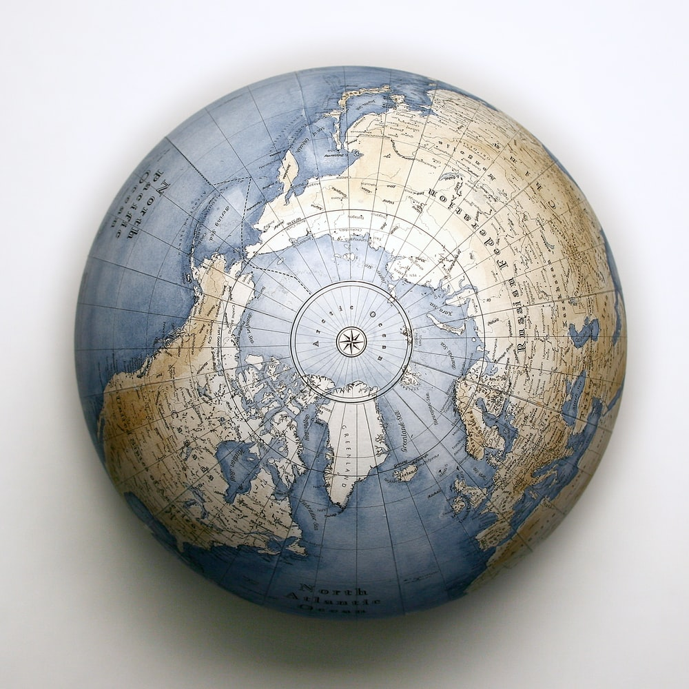 brown and black globe on white table