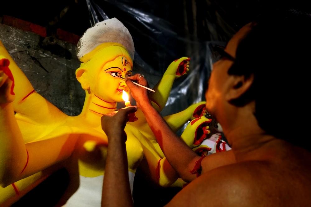 woman in yellow shirt smoking cigarette