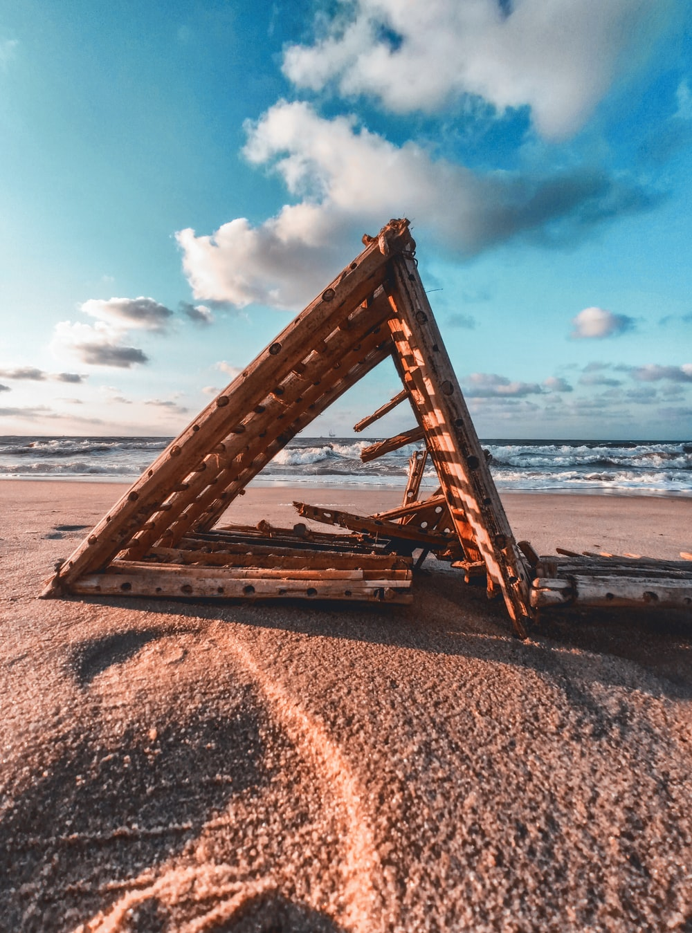 brown wooden ladder on beach shore during daytime