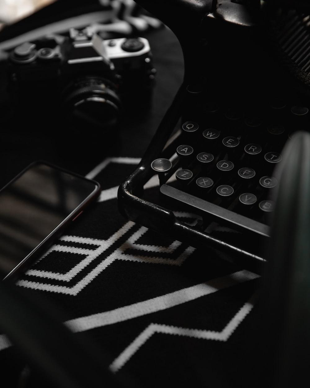 black and white typewriter on black and white textile
