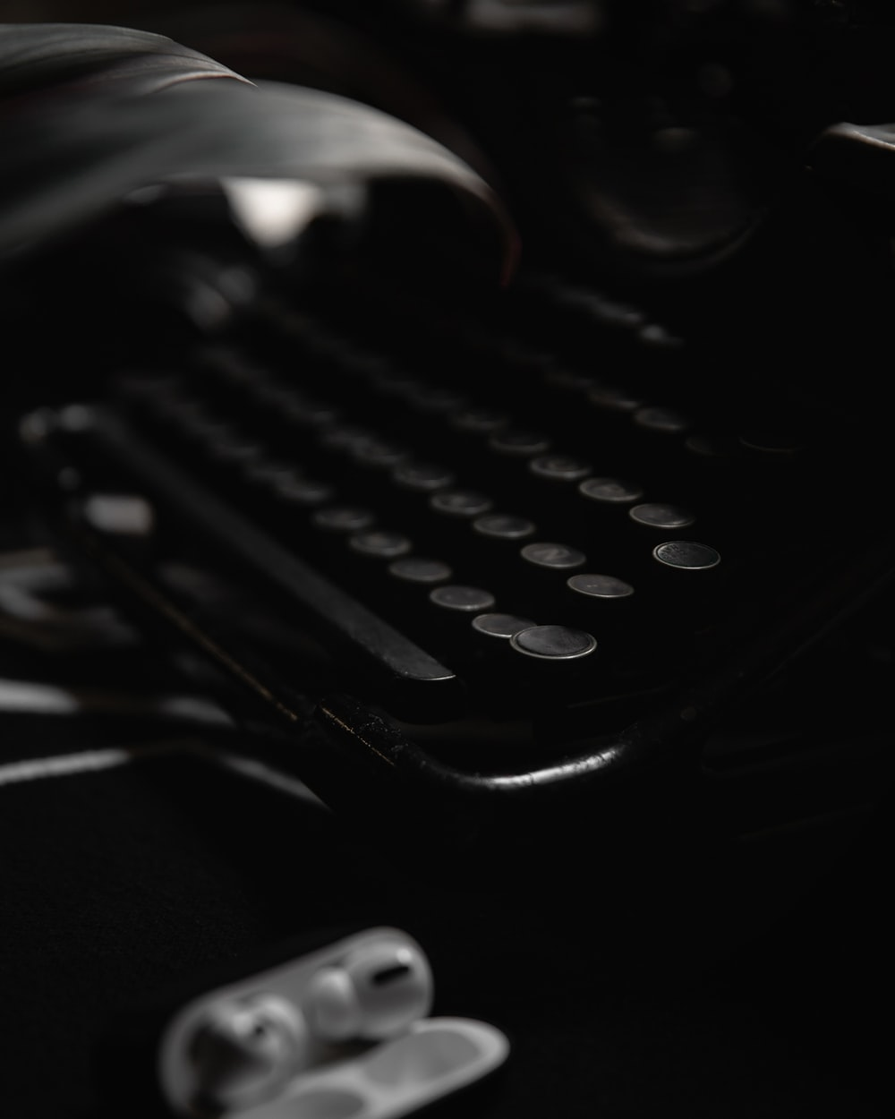 black and silver typewriter on black table