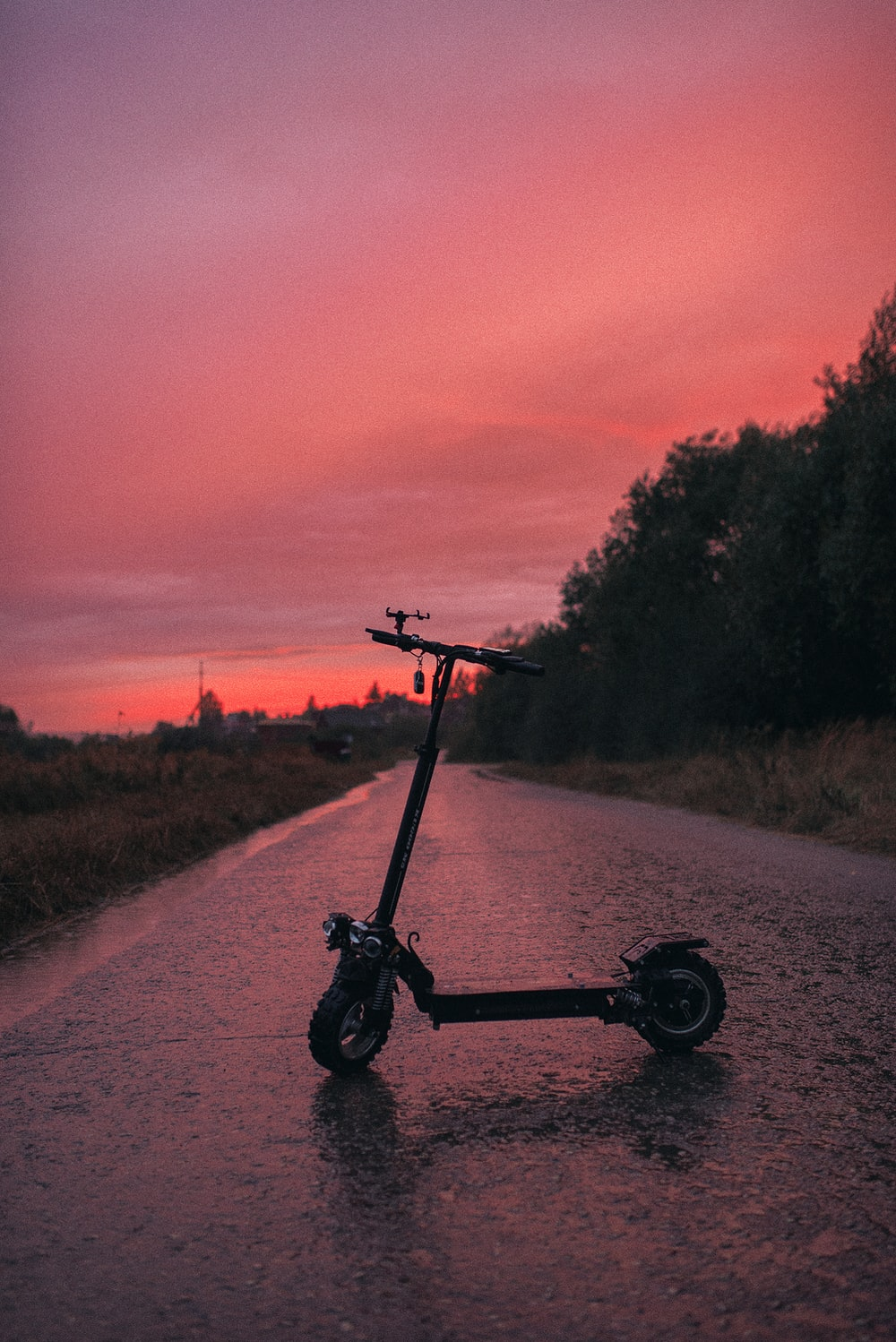 black and gray bicycle on road during sunset