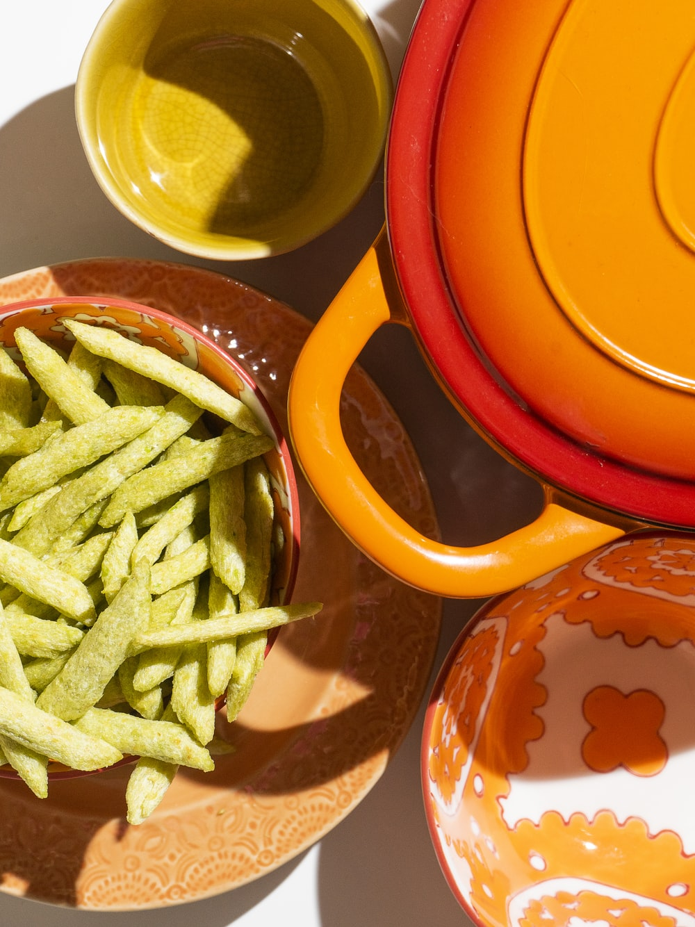 green vegetable on red ceramic plate