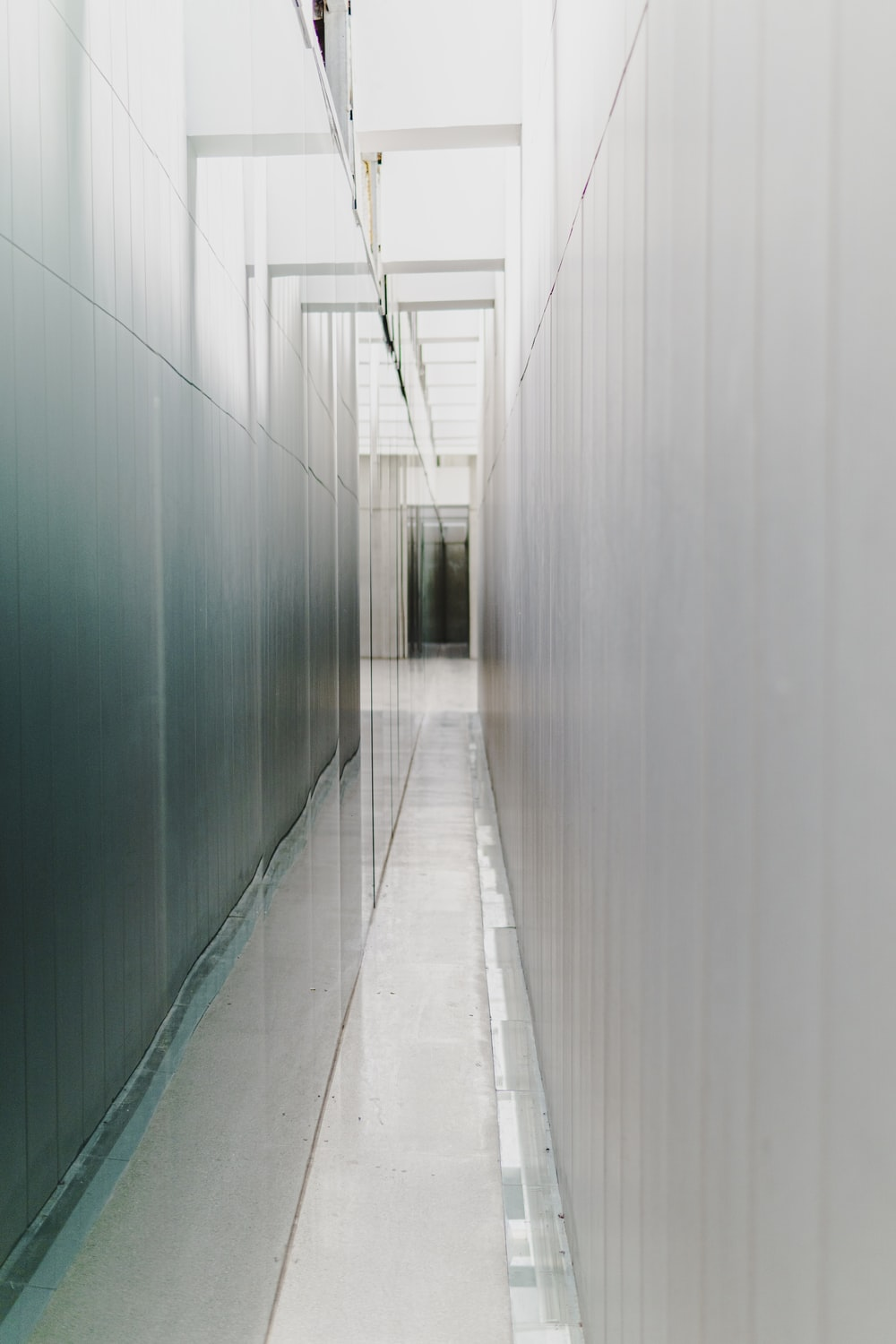 white hallway with green walls