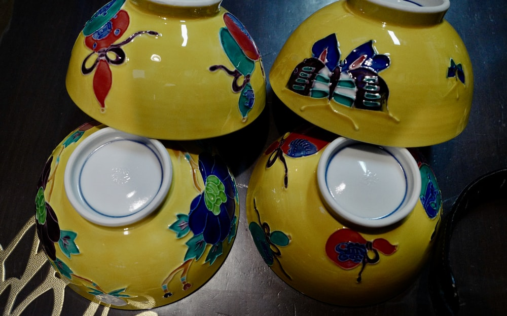 blue and yellow ceramic bowl
