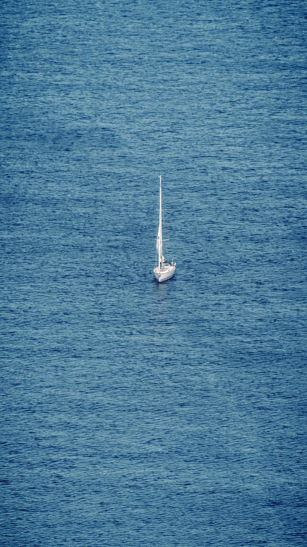 white sailboat on blue sea during daytime