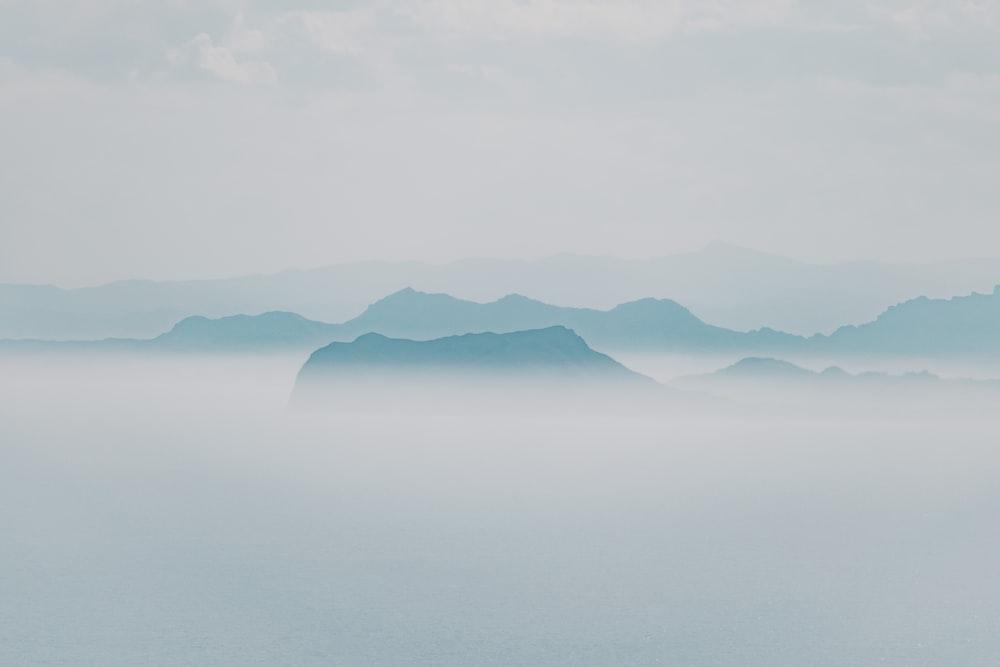 foggy mountain under gray sky