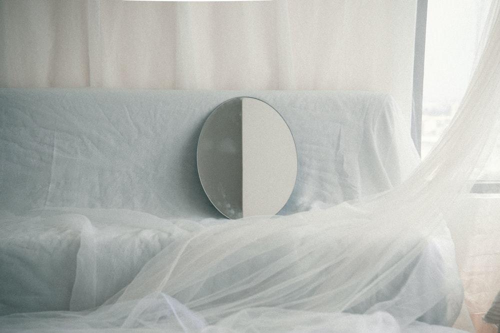white round plastic on white textile