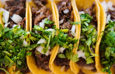 green vegetable on brown soil taco zoom background