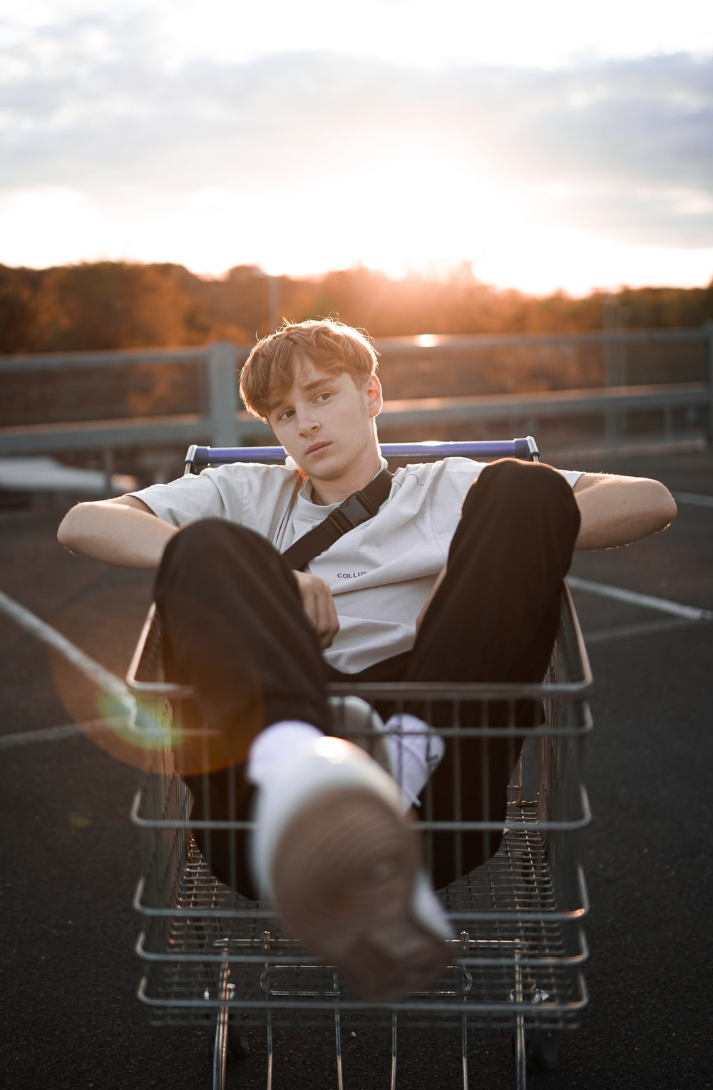 boy in black and white long sleeve shirt sitting on white metal chair