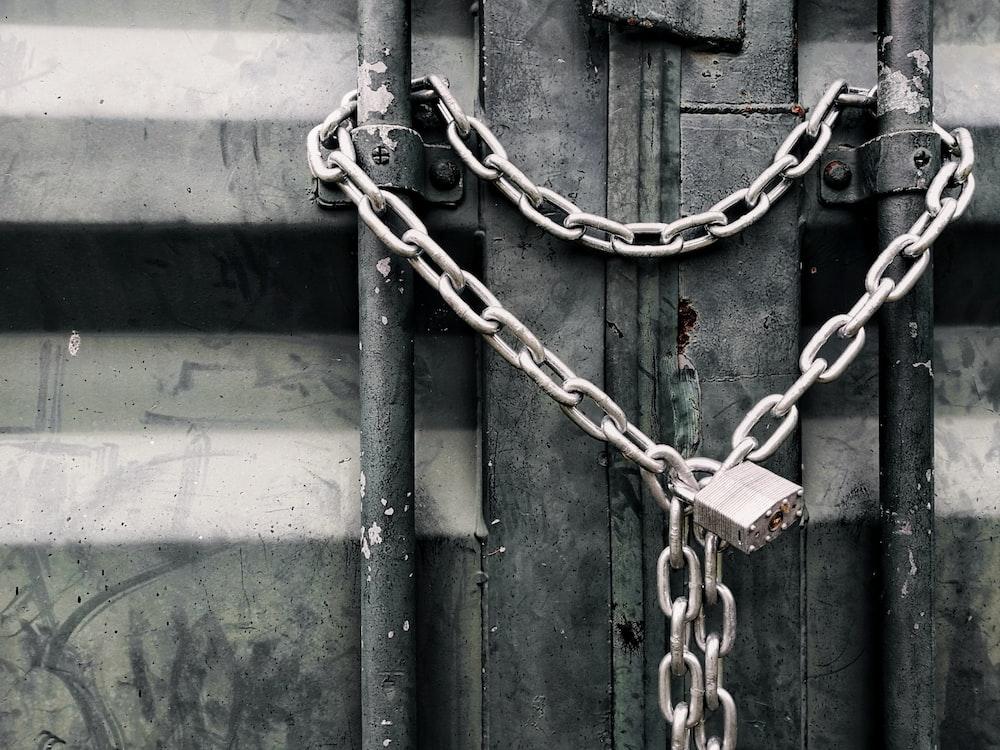 gray metal chain on green metal door
