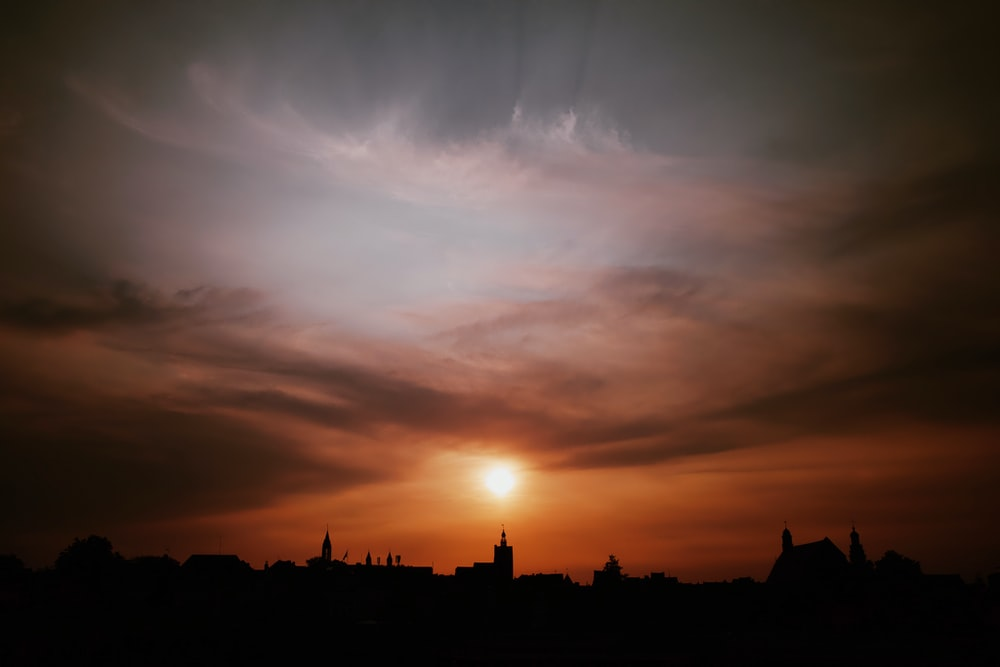 silhouette of buildings during sunset