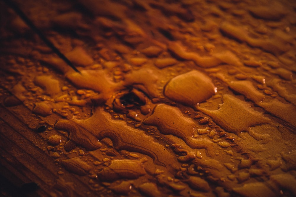 water droplets on brown surface