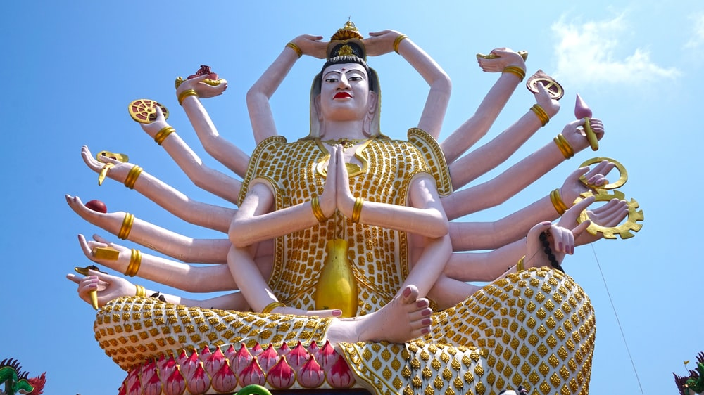 gold and white hindu deity statue
