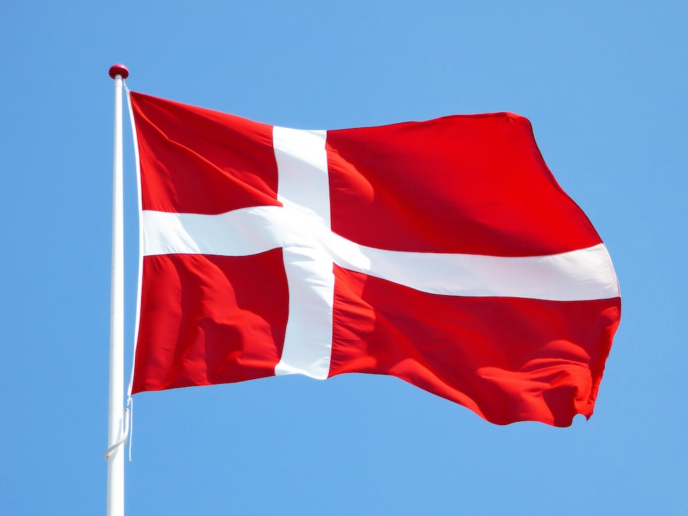 red and white flag on pole