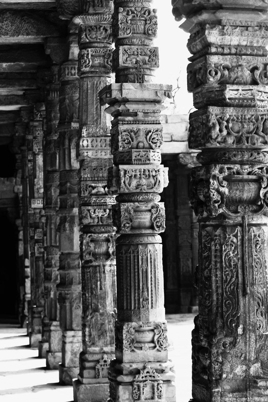 grayscale photo of concrete pillar
