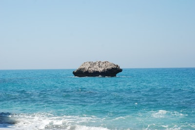 brown rock formation on sea during daytime cyprus zoom background