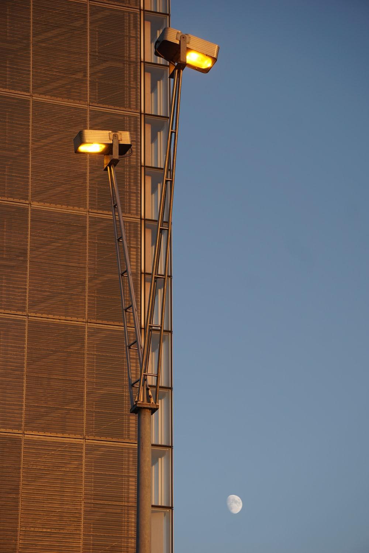 black street light turned on during daytime