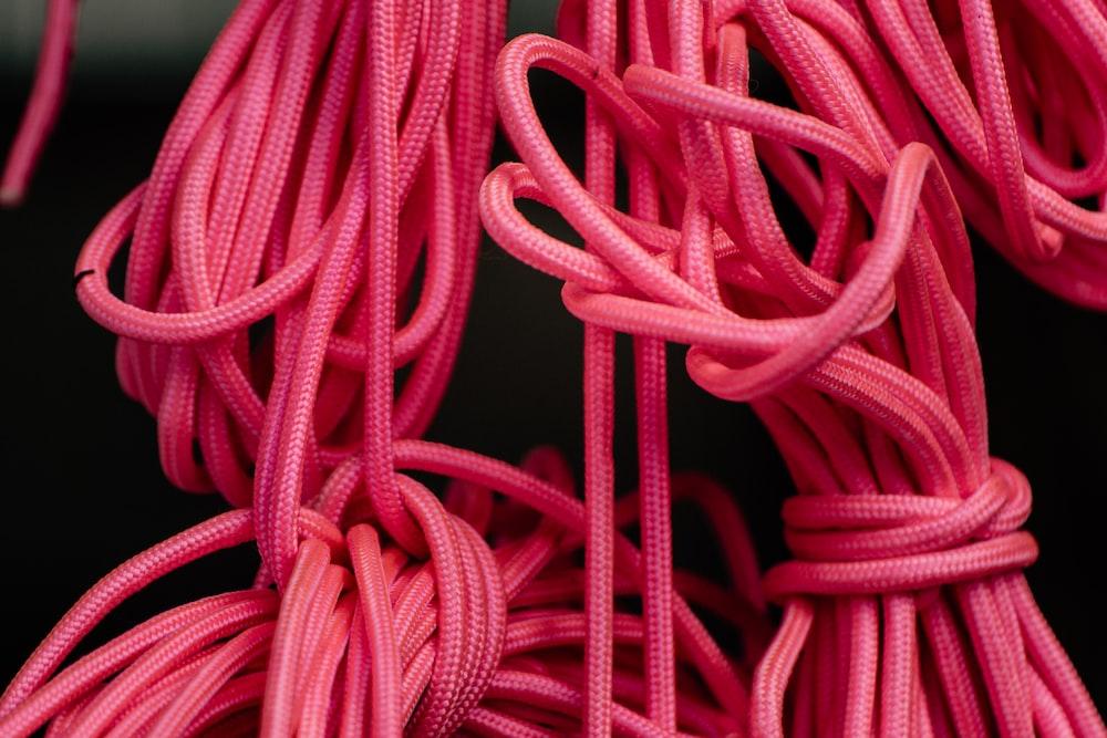 pink rope on black textile