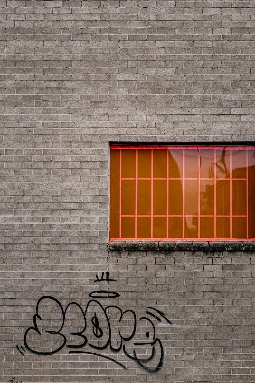 black bicycle parked beside brown wooden window