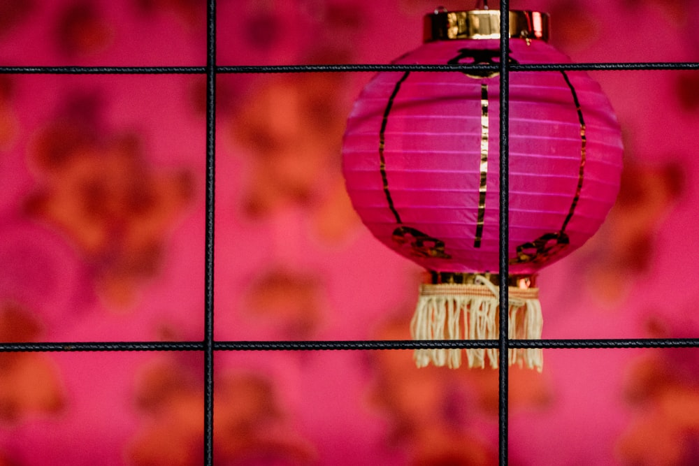 pink and white bauble on white metal rack