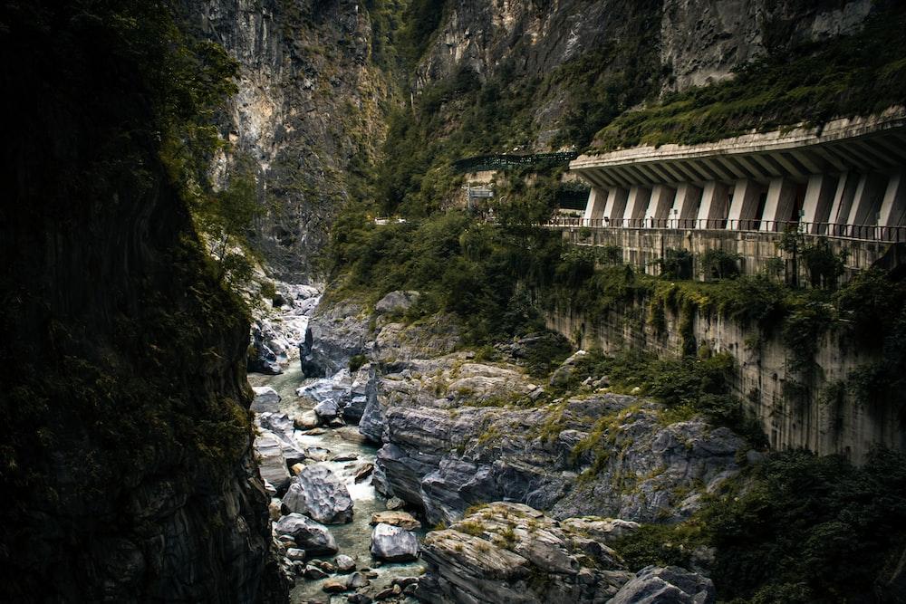brown wooden bridge on rocky mountain