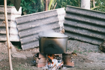 black kettle on fire near brown brick wall dutch colonial zoom background