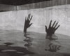 person in water in grayscale photography