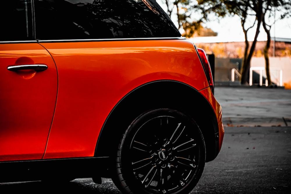 orange car on road during daytime