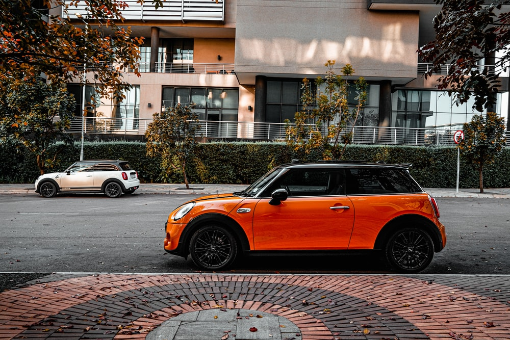 orange car parked on the side of the road