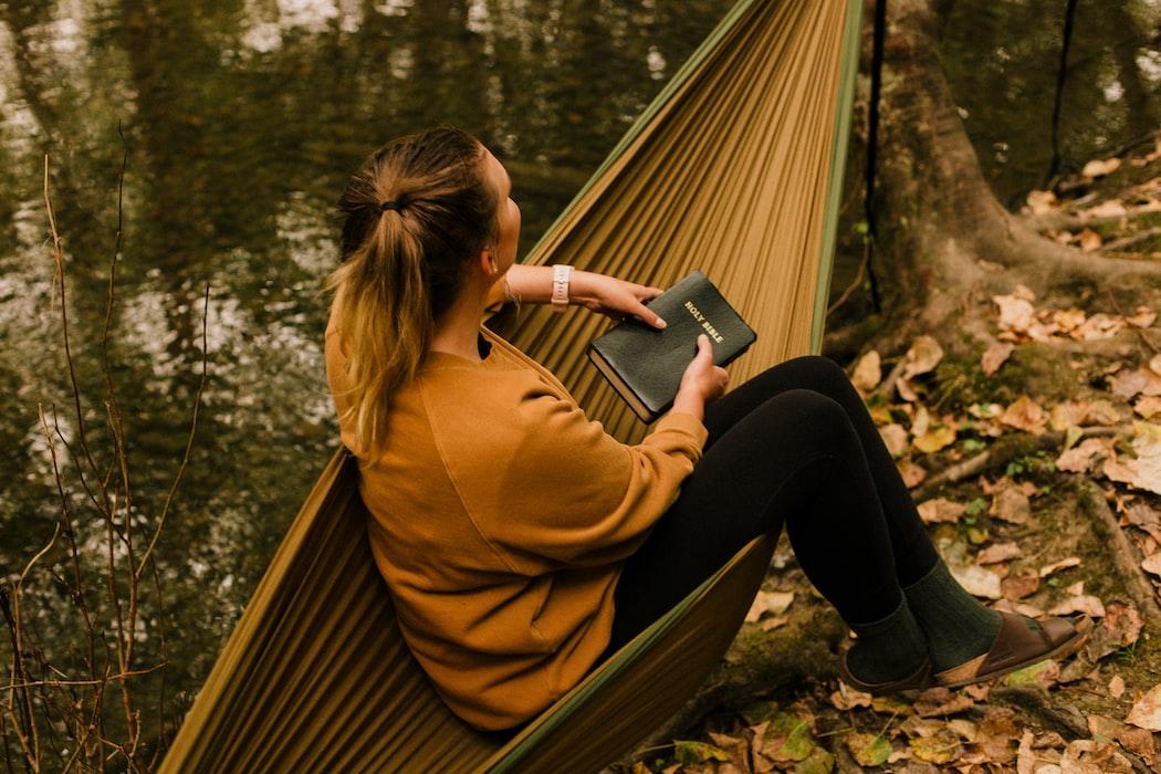woman spiritual camping in hammock