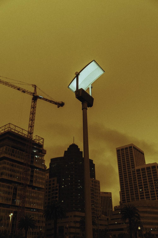 black crane near high rise building during daytime