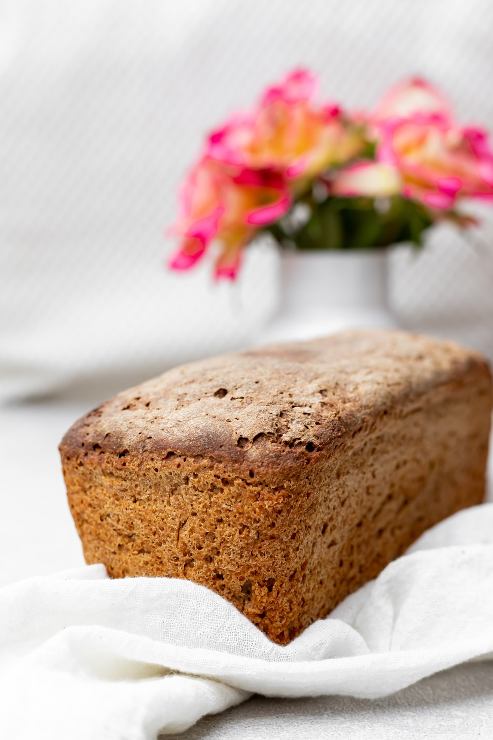 brown bread with pink and white flowers on white textile