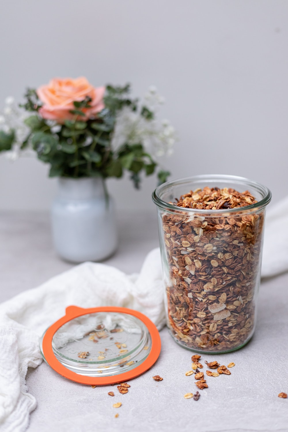 brown and white food in clear glass jar