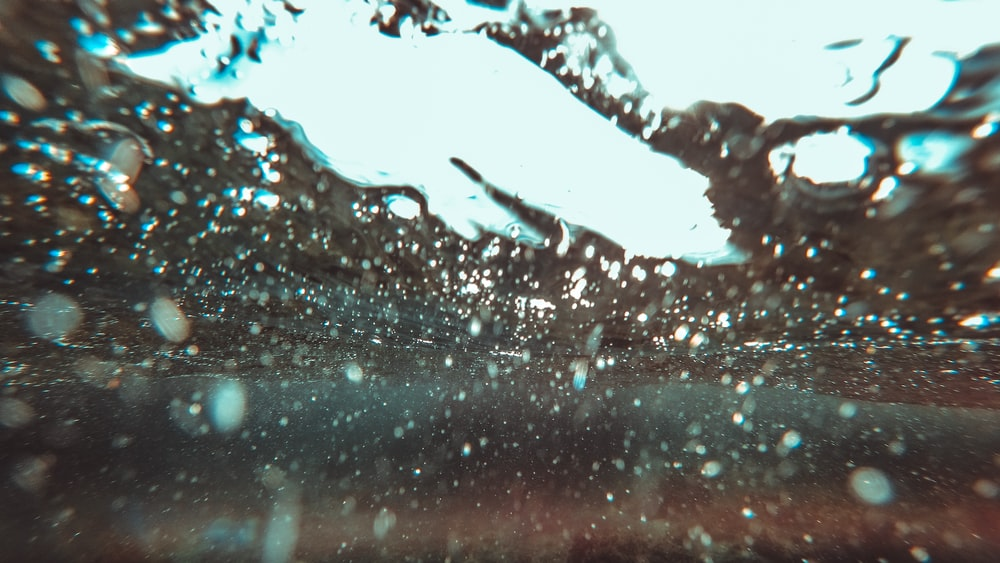 water droplets on glass during daytime