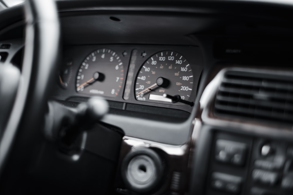 black and gray car instrument panel cluster