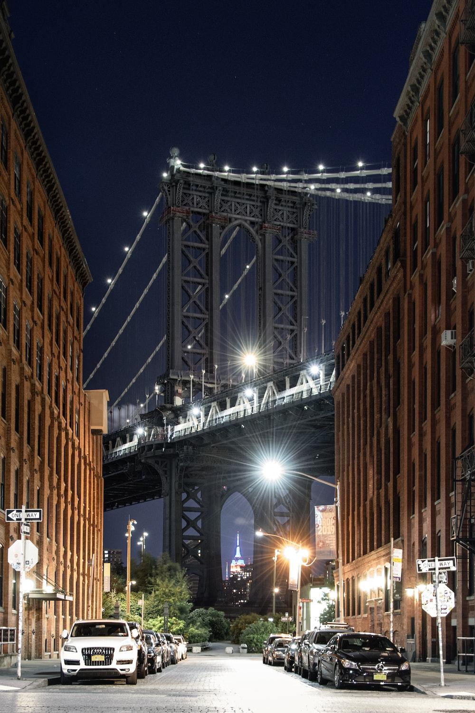 people walking on sidewalk near brown concrete building during night time