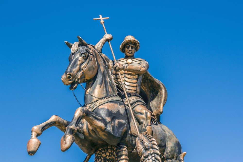 man riding on horse statue under blue sky during daytime