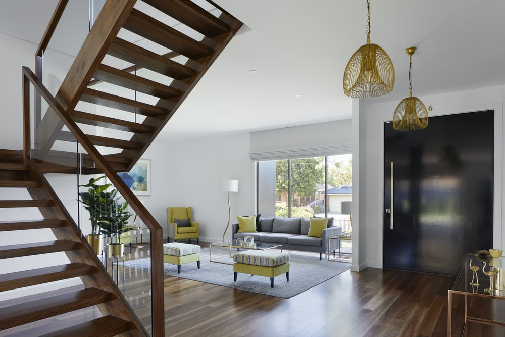 brown wooden spiral staircase near gray couch