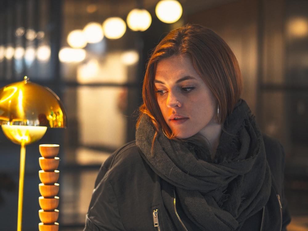 woman in black hoodie looking at the light