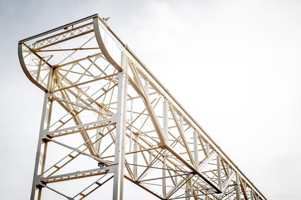 white metal tower under white sky during daytime