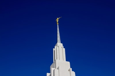 Moroni white concrete building under blue sky during daytime