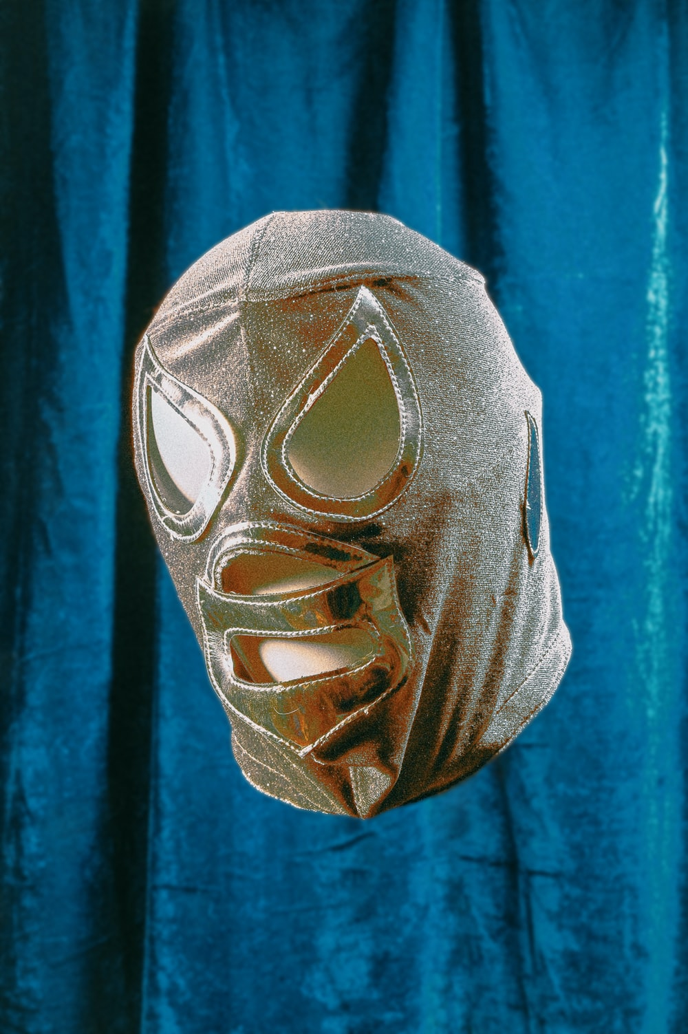 gray mask on blue textile