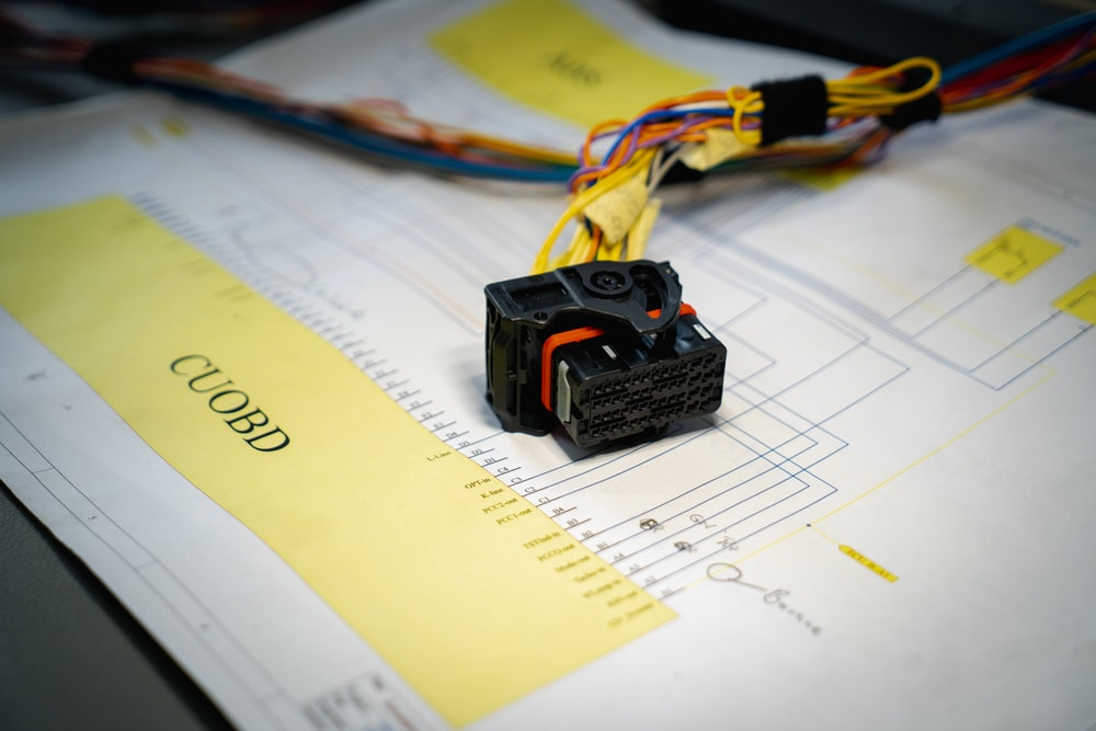 black and orange electronic device on white paper